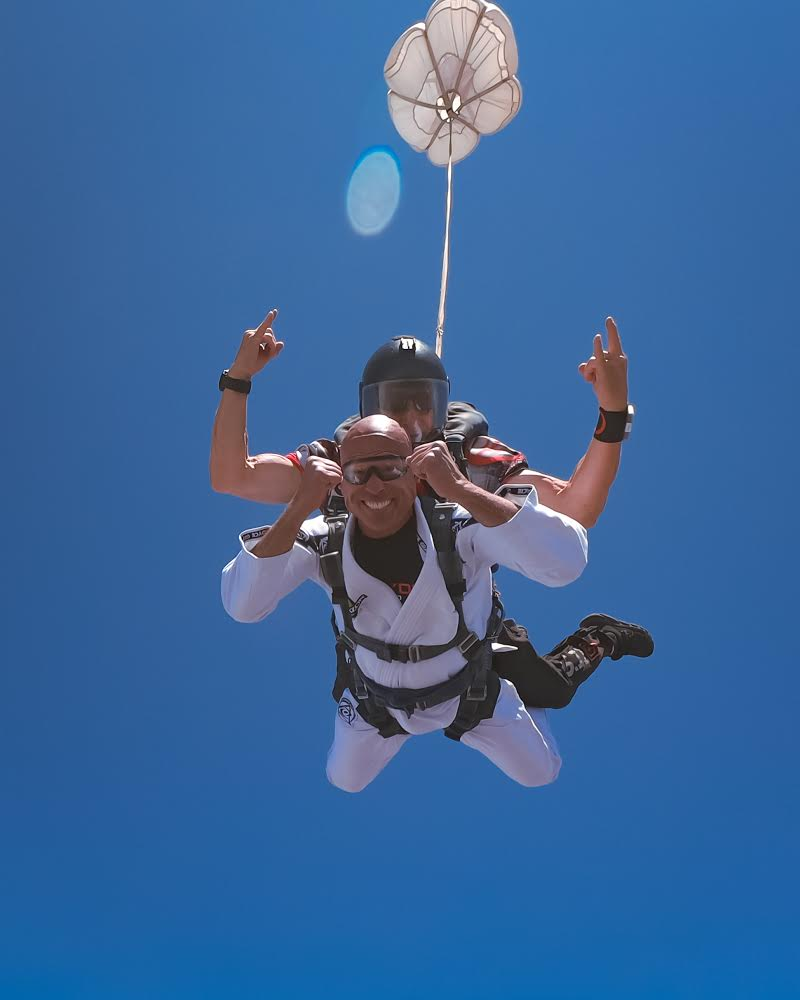 man in white skydiving with skydive san diego